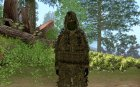 Sniper in forest camouflage
